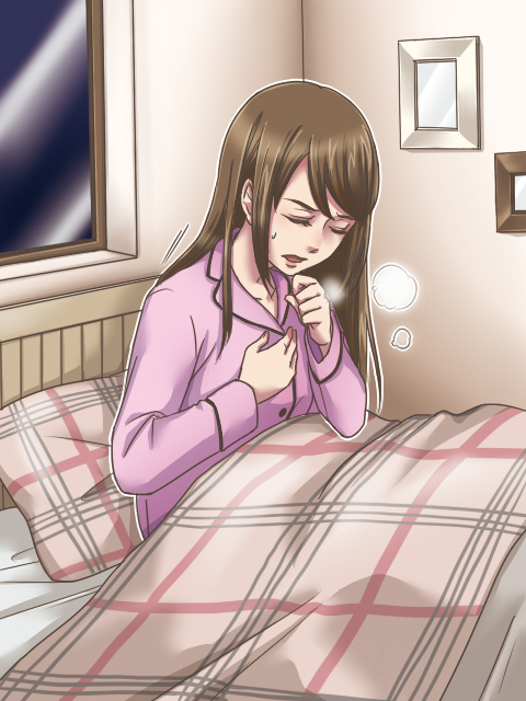 喘息発作で苦しむ女性